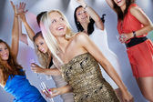 A group of young beautiful people dancing at a disco. — Stock Photo