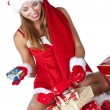 Beautiful sexy girl wearing santa claus clothes with christmas g — Stockfoto