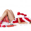 Beautiful sexy girl wearing santa claus clothes with christmas gifts — Stock Photo #35478779