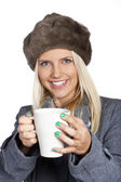 Winter woman with cup of tea — Stock Photo