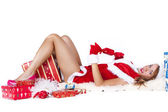 Beautiful sexy girl wearing santa claus clothes with christmas gifts — Stock Photo