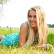 Стоковое фото: Woman relaxing outdoors looking happy and smiling