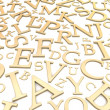 Golden letters background — Stock Photo #23138762