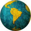 South american flags on globe map — Stock Photo
