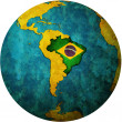 Brazil flag on globe map — Stock fotografie