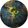 Brazil flag on globe map — Stok fotoğraf