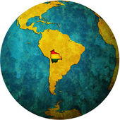 Bolivia flag on globe map — Stock Photo