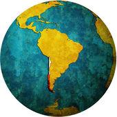Chile flag on globe map — Stock Photo