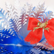 Bow and snowflake — Stock Photo
