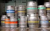 Stacked Barrels of Beer, metal pub kegs — Stock Photo