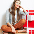 Woman portrait in christmas style with red, white box gift — Stock Photo #26232921