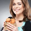 Woman holds a basket with easter eggs — Stock Photo