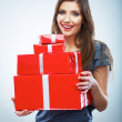 Portrait of young happy smiling woman hold red gift box. Isolat — Stock Photo #26232125