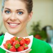 Stock Photo: Kitchen womstrawberry hold