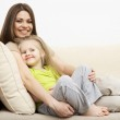 Smiling little girl with mother — Stock Photo