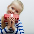 Girl hold red gift box with white ribbon. — Stock Photo