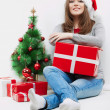 Christmas Santa hat isolated woman portrait hold christmas gift. — Stock Photo #26234173