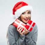 Christmas Santa hat isolated woman portrait hold christmas gift. — Stock Photo #26235261