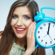 Young smiling woman hold watch. — Stockfoto