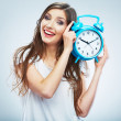 Stock Photo: Young smiling woman hold watch. Beautiful smiling girl portrait
