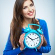 Young smiling woman in blue hold watch. Beautiful smiling girl — Stock Photo