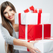 Young woman portrait hold many gift in christmas color style . — Stock Photo #26238315