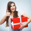Portrait of young happy smiling woma red gift box hold. — Stock Photo #26238475