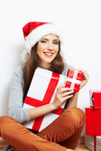 Christmas Santa hat isolaed woman portrait hold christmas gift — Stock Photo