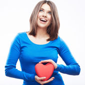 Smiling young woman hold red heart — Stock Photo