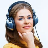 Woman with headphones listening music — Stock Photo
