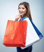 Portrait of happy smiling woman hold shopping bag. — Stock Photo