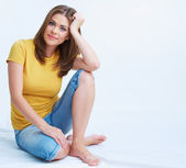 Young woman seating on floor — Stock Photo