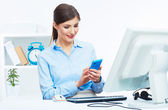Smiling business woman call center operator at work — Stock Photo