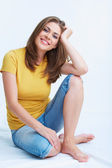 Yong woman sitting on floor, — Stock Photo