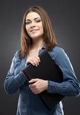 Smiling secretary with black paper folder — Stock Photo