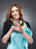 Happy woman with a shopping cart — Stock Photo