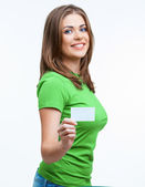 Young smiling woman show blank card. — Stock Photo
