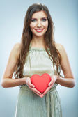 Beautiful woman holding Valentine day symbol — Stock Photo