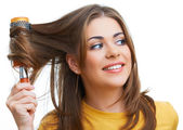 Young smiling woman hair dress makes — Stock Photo