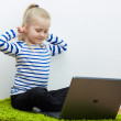Kid girl using laptop — Stock Photo