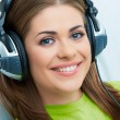 Smiling Woman listen music — Stock Photo