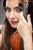 Music violin. Female face close up — Stock Photo