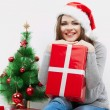 Christmas Santa hat isolated woman portrait hold christmas gift. — Stockfoto