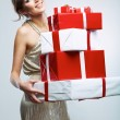 Young woman hold many red, white gift box . Female model isolat — Stock Photo