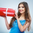 Young smile woman hold red giet box with white ribbon. — Stock Photo