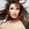 Beautiful female face with hair motion  — Stock Photo
