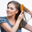 Постер, плакат: Woman combs hair