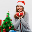 Christmas santa woman with christmas gift — Stock Photo