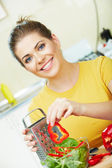 Woman cooking food in the kitchen — Stock Photo