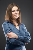 Businesswoman with folded hands — Stock Photo